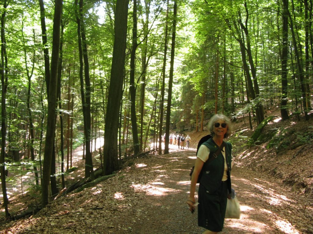 Chris in a German municipal forest on the SAF Tour, wearing the traditional German Forester's Tracht (uniform) she inherited from her East German forester friend Christine Neise.