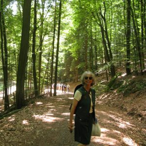 Feature: Chris in a German municipal forest on the SAF Tour, wearing the traditional German Forester's Tracht (uniform) she inherited from her East German forester friend Christine Neise.